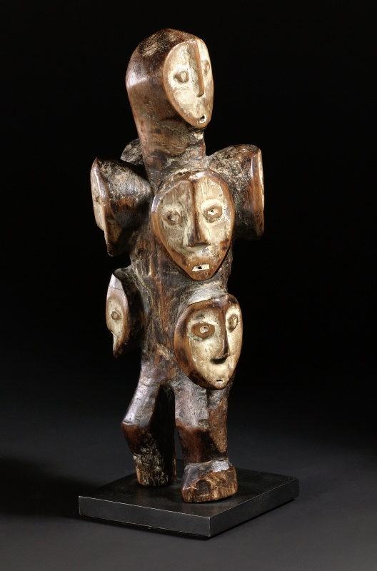 Victor Teicher, IAWIA | An ancient statue of multiple faces stacked together.